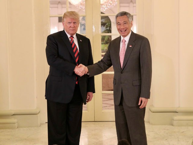 U.S. President Donald Trump (L) meets with Singapore's Prime Minister Lee Hsien Loong (R) to attend a bilateral meeting at the Istana, Singapore on June 11, 2018. (Photo by Ministry of Communications and Information, Republic of Singapore / Handout/Anadolu Agency/Getty Images)