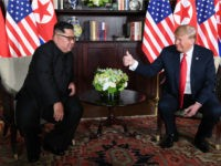 US President Donald Trump (R) gives a thumbs up as he sits down with North Korea's leader Kim Jong Un (L) for their historic US-North Korea summit, at the Capella Hotel on Sentosa island in Singapore on June 12, 2018. - Donald Trump and Kim Jong Un have become on …