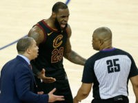 LeBron James and Cleveland Cavaliers coach, Tyronn Lue, react to a call reversal in Game 1 of the 2018 NBA Finals.