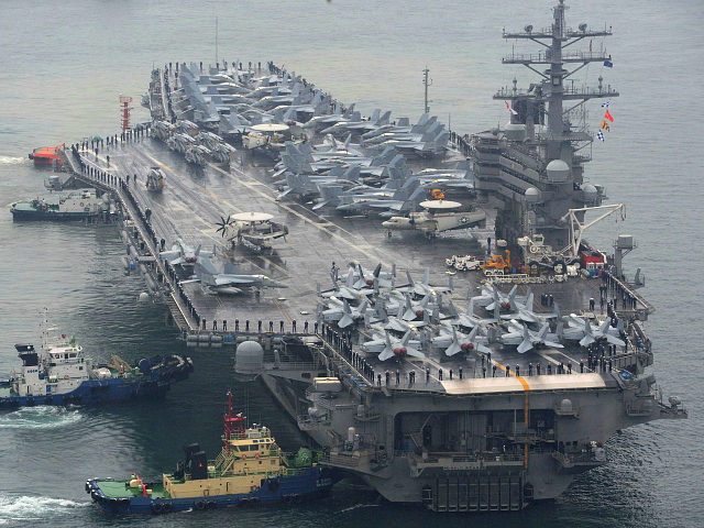The USS Ronald Reagan aircraft carrier is escorted into Busan port, South Korea, after completing a joint drill with the South Korean navy in southern waters off the Korean Peninsula, Sunday, Oct. 16, 2016. South Korea and the U.S. said Sunday that the latest missile launch by North Korea ended …