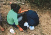 Cindy Vanessa Mendez kneels over her father's body. Omar Mendez Perez died after being left behind by human smugglers after he fell ill and was unable to keep up. (Photo: Brooks County Sheriff's Office)