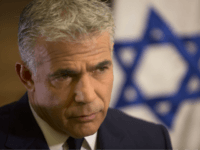 In this Monday, Oct. 31, 2016 photo, Israeli Knesset member, Yair Lapid, leader of the Yesh Atid party, gives an interview to The Associated Press, in his office at the Knesset, Israel's parliament, in Jerusalem. Lapid believes he has finally found a formula that will allow him to do something …