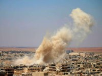 Smoke rises above opposition held areas of Daraa during an airstrike by Syrian regime forces, on June 25, 2018. - Russian-backed regime forces have for weeks been preparing an offensive to retake Syria's south, a strategic zone that borders both Jordan and the Israeli-occupied Golan Heights. (Photo by Mohamad ABAZEED …