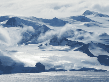 Mountains stand near the coast of West Antarctica as seen from a window of a NASA Operation IceBridge airplane on October 27, 2016 in-flight over Antarctica. NASA's Operation IceBridge has been studying how polar ice has evolved over the past eight years and is currently flying a set of 12-hour …