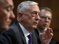 Defense Secretary Jim Mattis, center, attends a hearing on the Department of Defense budget posture, with Joint Chiefs Chairman Gen. Joseph Dunford, left, and Defense Under Secretary and Chief Financial Officer David Norquist, right, during a Senate Armed Services Committee hearing, Thursday April 26, 2018, on Capitol Hill in Washington. …