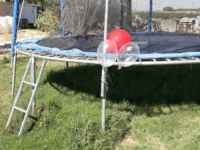 TEL AVIV - A bunch of balloons outfitted with an explosive device that was flown over from the Gaza Strip landed on a trampoline in the backyard of an Israeli family's home Wednesday, prompting a mother to instruct her children to stay away.