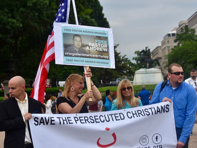 Dede Laugsen of Save the Persecuted Christians (with flag) joined the protest in front of the White House on Wednesday to show support for Andrew Brunson, an American-born pastor who is jailed in Turkey for charges he aided terrorists. (Penny Starr/Breitbart News)
