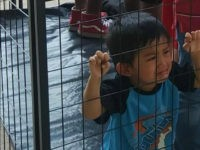 Fact Check: 'Caged' Child Photo Is Not What Immigration Advocates Claim