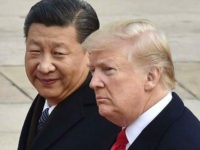 File photo taken in November 2017 shows U.S. President Donald Trump (R) and Chinese President Xi Jinping attending a welcome ceremony in Beijing. Trump announced tariffs on $60 billion of imports from China on March 22, 2018, in response to what he sees as China's unfair trade and investment practices. …