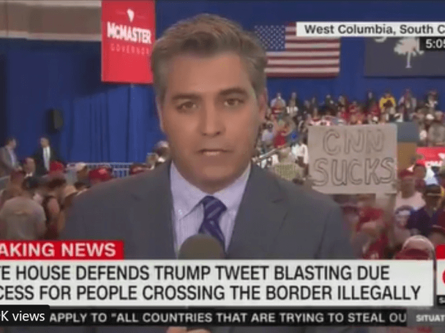 Man with 'CNN Sucks' Sign Crashes Jim Acosta's Broadcast Ahead of Trump-McMaster Rally