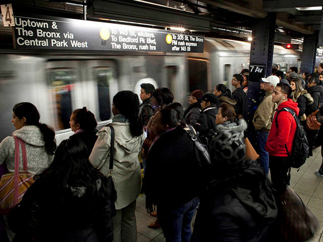 ROCKAWAY, NY - NOVEMBER 4: Commuters wait for the D train November 4, 2012 in New York City. A week after Superstorm Sandy hit the city, most of the subway lines are running, with some lines still suspended and others running on a limited basis. (Photo by Allison Joyce/Getty Images)