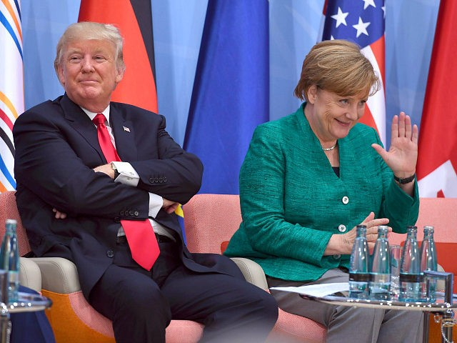 "US President Donald Trump, left, and German Chancellor Angela Merkel attend the panel discussion ""Launch Event Women's Entrepreneur Finance Initiative"" on the second day of the G-20 summit in Hamburg, Germany, Saturday, July 8, 2017. (Patrik Stollarz/Pool Photo via AP)"