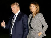 U.S. President Donald Trump, left, gives a thumbs-up as he walks with First Lady Melania Trump on the South Lawn of the White House after landing on Marine One following an event at Joint Base Andrews in Washington, D.C., U.S., on Thursday, May 10, 2018.Trumppersonally welcomed home three Americans released …