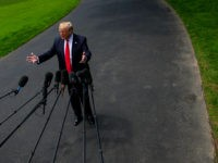 U.S. President Donald Trump speaks to members of the media before departing for New York on the South Lawn of the White House in Washington, D.C., on Wednesday, May 23, 2018. Secretary of State Mike Pompeo acknowledged -- after prodding by lawmakers -- that he backs the finding by U.S. intelligence agencies …