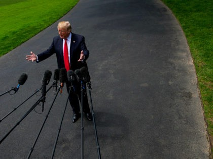 U.S. President Donald Trump speaks to members of the media before departing for New York on the South Lawn of the White House in Washington, D.C., on Wednesday, May 23, 2018. Secretary of StateMike Pompeoacknowledged -- after prodding by lawmakers -- that he backs the finding by U.S. intelligence agencies …