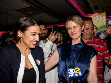 Progressive challenger Alexandria Ocasio-Cortez is joined by New York gubenatorial candidate Cynthia Nixon at her victory party in the Bronx after upsetting incumbent Democratic Representative Joseph Crowly on June 26, 2018 in New York City. Ocasio-Cortez upset Rep. Joseph Crowley in New York's 14th Congressional District, which includes parts of …