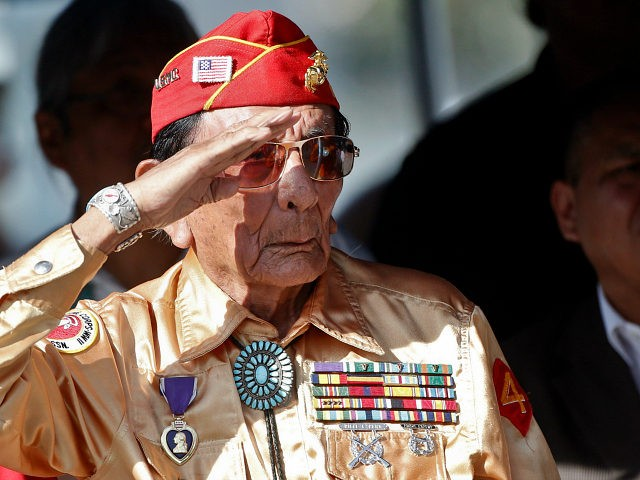 Former United States Marine and Navajo code talker Sam Holiday salutes the flag at a ceremony honoring the Navajo Code Talkers and their contributions to the American war effort in World War II on Monday, Sept. 28, 2015, at Camp Pendleton, Calif. (AP Photo/Lenny Ignelzi)