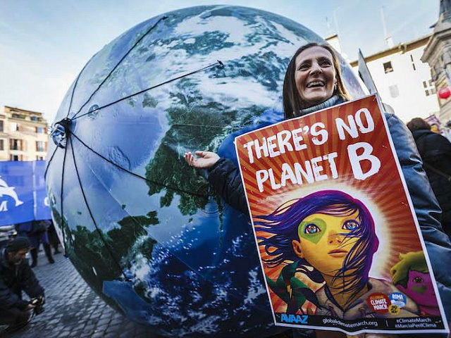 ROME, ITALY - 2015/11/29: Thousands of citizens and environmental activists take part in the 'Global Climate March' to call for tougher action to tackle climate change in Rome. The awareness event took place ahead of the 21st Session of the Conference of the Parties to the United Nations Framework Convention …