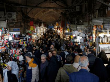 Iranians shop at Tehran's ancient Grand Bazaar on January 4, 2018. / AFP PHOTO / ATTA KENARE (Photo credit should read ATTA KENARE/AFP/Getty Images)