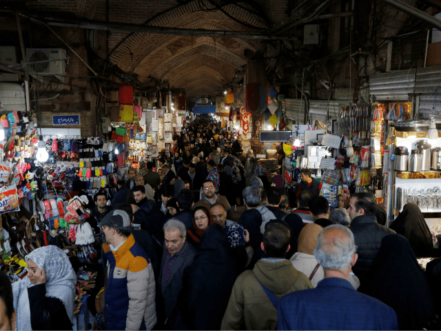 Iranians shop at Tehran's ancient Grand Bazaar on January 4, 2018. / AFP PHOTO / ATTA KENARE (Photo credit should read ATTA KENARE/AFP/Getty Images)