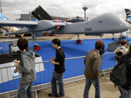 Visitors look at an Israel Aerospace Industries-made drone, Heron TP, on the last day of the 47th Paris Air Show in Le Bourget, north of Paris, Sunday June 24, 2007. The Heron TP is a medium altitude long endurance UAV system. (AP Photo/Remy de la Mauviniere)