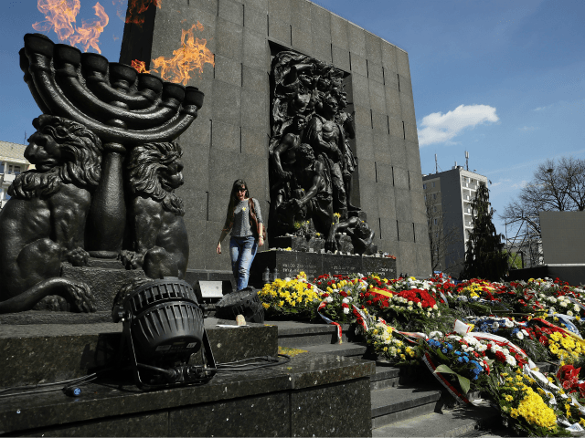 A woman descend after laying a candle at the Ghetto Heroes Monument following the main commemoration ceremony of the 75th anniversary of the Warsaw Ghetto Uprising on April 19, 2018 in Warsaw, Poland. The Warsaw Ghetto was a prison created by the German military during its occupation of Warsaw during …