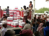 Yemenis drop off boxes of humanitarian aid provided by the Emirati Red Crescent in the coastal town of Mujailis, south of the city of Hodeida, on June 6, 2018. (Photo by NABIL HASSAN / AFP) (Photo credit should read NABIL HASSAN/AFP/Getty Images)