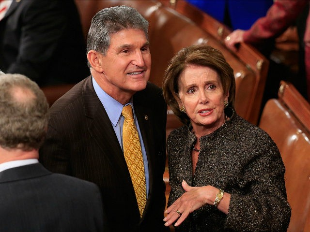 WASHINGTON, DC - JANUARY 20: House Minority Leader Nancy Pelosi (R) (D-CA) talks with Sen. Joe Manchin (L) (D-WV) before the start of the State of the Union speech in the House chamber of the U.S. Capitol January 20, 2015 in Washington, DC. U.S. President Barack Obama was expected to …