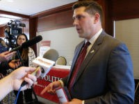 FILE - In this Jan. 30, 2018, file photo, Wisconsin Republican Senate candidate Kevin Nicholson speaks with reporters in Madison, Wis. Nicholson's opponent in the Aug. 14, 2018, primary is state Sen. Leah Vukmir. Nicholson submitted his nomination papers to get on the ballot with the state Elections Commission on …