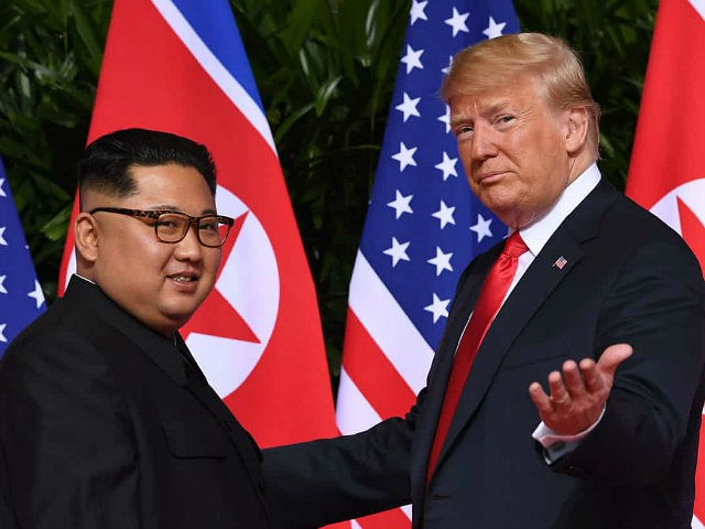 US President Donald Trump (R) gestures as he meets with North Korea's leader Kim Jong Un (L) at the start of their historic US-North Korea summit, at the Capella Hotel on Sentosa island in Singapore on June 12, 2018. - Donald Trump and Kim Jong Un have become on June …