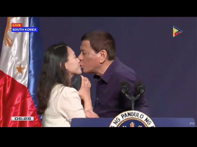 KISS ON THE LIPS. President Rodrigo Duterte kisses an overseas Filipino worker during his meeting with the Filipino community in South Korea on June 3, 2018. Screenshot from PTV video