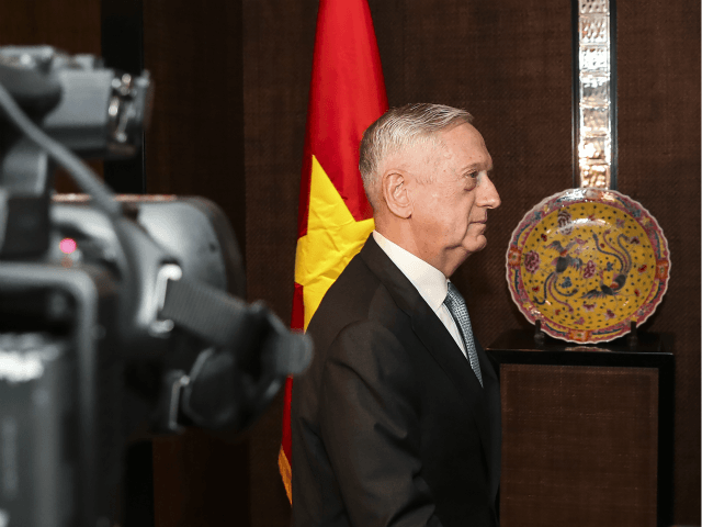 U.S. Defense Secretary Jim Mattis arrives for a bilateral meeting with Vietnam's Defense Minister Ngo Xuan Lich during the International Institute for Strategic Studies (IISS) Shangri-la Dialogue, an annual defense and security forum in Asia, in Singapore, Friday, June 1, 2018. (AP Photo/Yong Teck Lim)