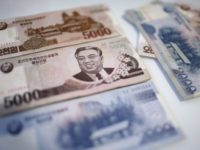 Kim Il Sung is seen on the 5,000 bill of the North Korean won, Monday, Feb. 6, 2017. While foreign brand-name goods are often paid for in the U.S. dollars, Euros or Chinese yuan, and priced accordingly at the official exchange rate, most people buy their daily necessities in North …
