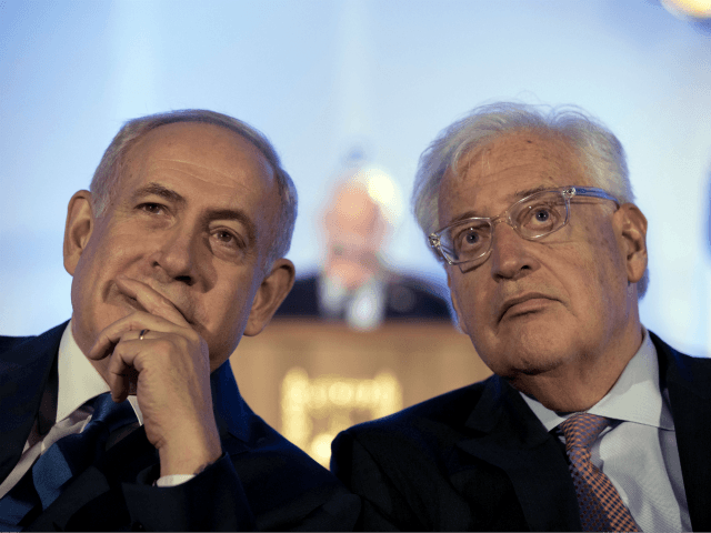 Israeli Prime Minister Benjamin Netanyahu, left and David Friedman, right, the new United States Ambassador to Israel attend a ceremony celebrating the 50th anniversary of the liberation and unification of Jerusalem, in front of the walls of the Old City of Jerusalem, Sunday, May 21, 2017. Israel captured the Old …
