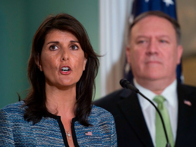 US Secretary of State Mike Pompeo looks on as US Ambassador to the United Nation Nikki Haley speaks at the US Department of State in Washington DC on June 19, 2018. - The United States announced that it is withdrawing from the UN Human Rights Council. (Photo by Andrew CABALLERO-REYNOLDS …
