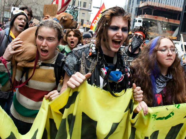 Occupy Wall Street demonstrators march near Zuccotti Park on Saturday, March 17, 2012, in New York. With the city's attention focused on the huge St. Patrick's Day Parade many blocks uptown, the Occupy rally at Zuccotti Park on Saturday drew a far smaller crowd than the demonstrations seen in the …