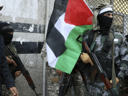 Masked militants from Al Aqsa Martyrs' Brigade, a militia linked to the Fatah movement, hold their rifles and the Palestinian flag during a press conference to condemn the decision by U.S. President Trump to recognize Jerusalem as Israel's capital, in Gaza City, Thursday, Dec. 7, 2017. A number of U.S. …