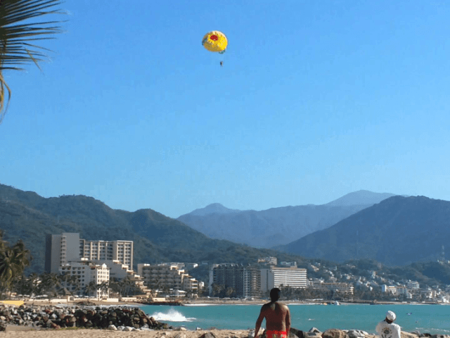 Woman injured after parasail rope breaks