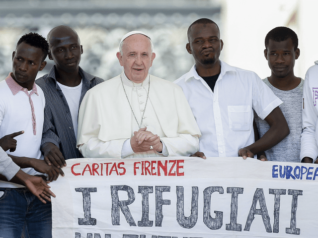 Pope Francis poses for a photo with a group of refugees he invited to join him on the steps of St. Peter's Basilica during his weekly general audience in St. Peter's Square at the Vatican, Wednesday, June 22, 2016. Pope Francis has invited a dozen refugees to join him on …