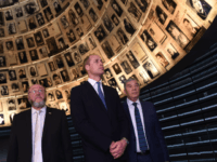 Britain's Prince William (C), Chief Rabbi Ephraim Mirvis of the United Congregations of the Commonwealth (L) and chairman of Yad Vashem Avner Shalev, tour the Yad Vashem Holocaust memorial in Jerusalem on June 26, 2018. - Britain's Prince William arrived in Israel the previous night, the first member of the …