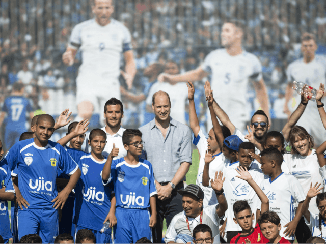 Britain's Prince William poses with Jewish and Arab children in Jaffa, Israel on Tuesday, June 26, 2018. (Heidi Levine/Pool photo via AP)