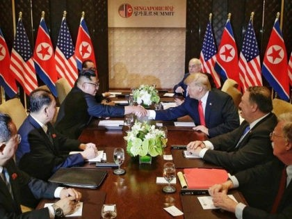 SINGAPORE - JUNE 12: (----EDITORIAL USE ONLY MANDATORY CREDIT - 'KEVIN LIM / THE STRAITS TIMES / HANDOUT' - NO MARKETING NO ADVERTISING CAMPAIGNS - DISTRIBUTED AS A SERVICE TO CLIENTS----) U.S. President Donald Trump (3rd R) and North Korea's leader Kim Jong Un (3rd L) shake hands as they …