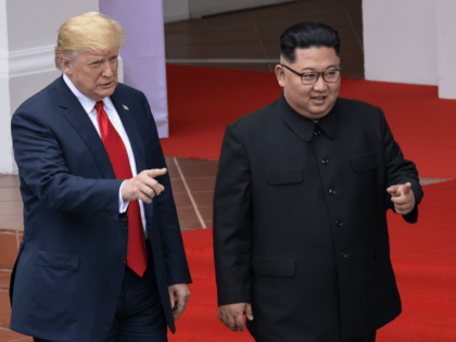 US President Donald Trump and North Korea leader Kim Jong Un walk from lunch at the Capella resort on Sentosa Island in Singapore on June 12, 2018. - Donald Trump and Kim Jong Un became on June 12, the first sitting US and North Korean leaders to meet, shake hands …