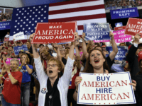 People cheer as President Donald Trump speaks at a rally at AMSOIL Arena in Duluth, Minn., Wednesday, June 20, 2018. (AP Photo/Susan Walsh)