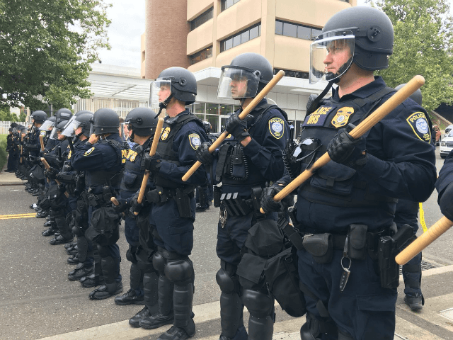 Federal officials dressed in riot gear arrested eight protesters camped out in front of Portland, Oregon's, U.S. Immigration and Customs Enforcement (ICE) facility on Thursday.