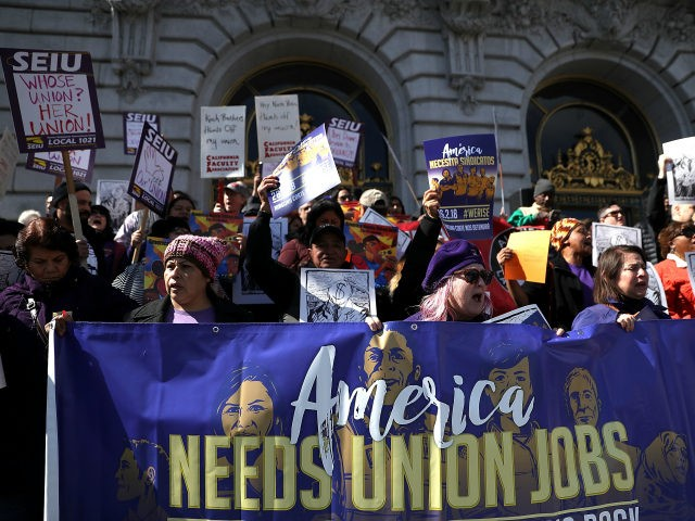 Union members hold signs during a rally outside of San Francisco City Hall on February 26, 2018 in San Francisco, California. Hundreds of union members held a rally outside of San Francisco City Hall as the US Supreme Court begins to hear oral arguments in the Janus V. AFSCME case …
