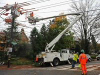 A Pepco crew repairing power lines in Washington. The company said it will cut customers' rates because of its savings from the new tax law.