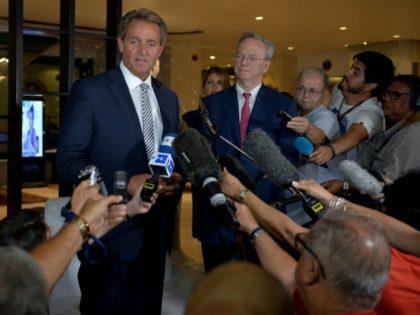 US Senator Jeff Flake, left, and Google board member Eric Schmidt visited Cuba