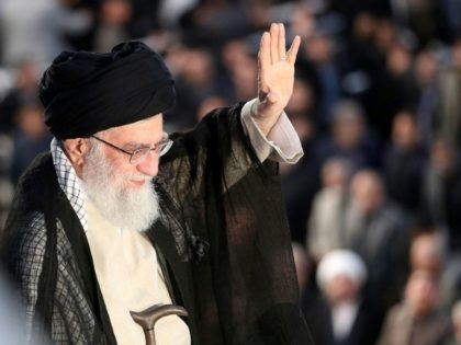 A handout picture from the office of Iran's Supreme Leader Ayatollah Ali Khamenei shows him greeting the crowd during a ceremony on June 4, 2018