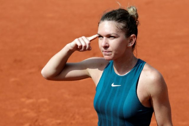 Won with the head: Simona Halep gestures as she beats Angelique Kerber during